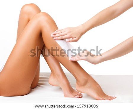 Well-groomed Woman Legs After Depilation Isolated on White Background - stock photo