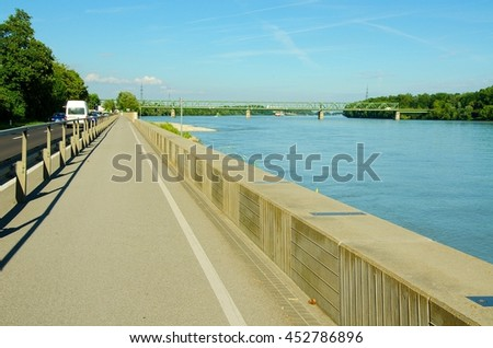 Well-known Danube cycle trail running along the Danube river in Austria. Danube bicycle track is among the most beautiful, oldest and longest cycling tracks in Europe. - stock photo