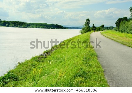 Well known Danube cycle trail runs along the Danube river in Austria. Danube cycle trail in the summer. - stock photo