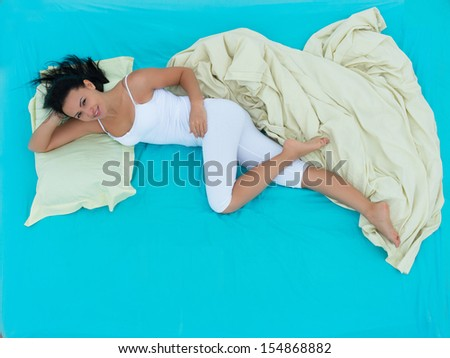 Well-rested girl waking up in the morning, view from above - stock photo