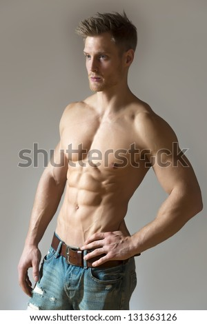 Well trained sport man with pectoral and abdominal muscle