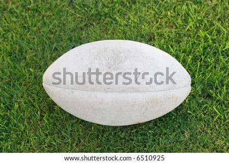 well used rugby ball - stock photo