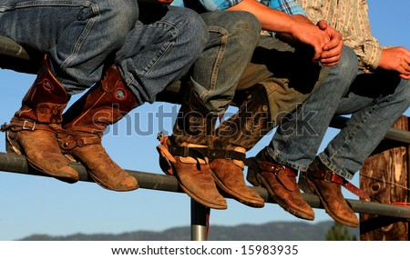 Well worn boots adorn the wranglers at rodeo in small county fair, Idaho