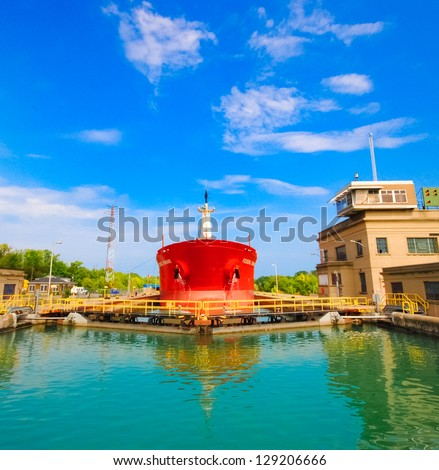 WELLAND CANAL-NOV. 7:This is the first set of locks situated on the Ontario entrance of the WELLAND Canal. On nov. 7 2011 in Canada. Ships are raised a total of 87 feet above sea. - stock photo