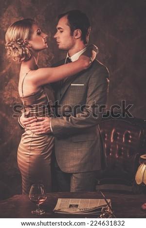 Welld-dressed couple in retro interior - stock photo