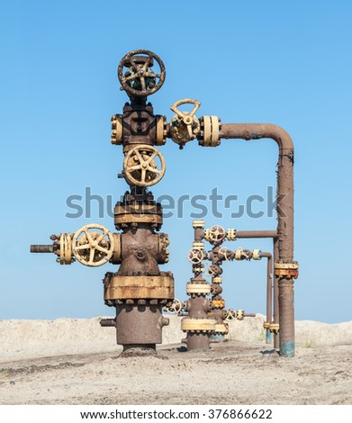 Wellhead with valve armature. Oil, gas industry. - stock photo