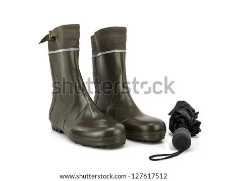 Wellington boots with umbrella on white background - stock photo