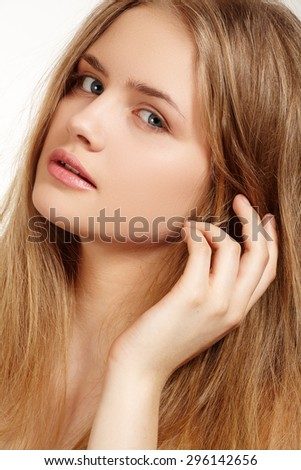 Wellness and spa. Sensual woman model with  blond hair on white background. Shiny long health hairstyle. Beauty and haircare. - stock photo
