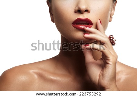 Wellness, cosmetics and chic style. Close-up portrait of sensuality beautiful woman model face with fashion make-up, sexy evening red lips makeup and bright red manicure