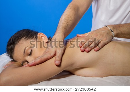 Wellness. Masseur doing massage on woman body in the spa salon. Beauty treatment concept. - stock photo
