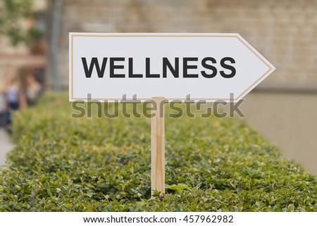 wellness signpost - stock photo