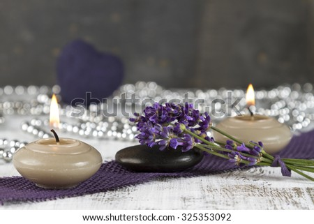 wellness therapy with lavender and hot stone - stock photo