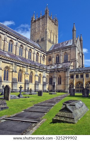Wells Cathedral (Cathedral Church of Saint Andrew), Wells Abbey and old cemetery, Somerset, England - stock photo