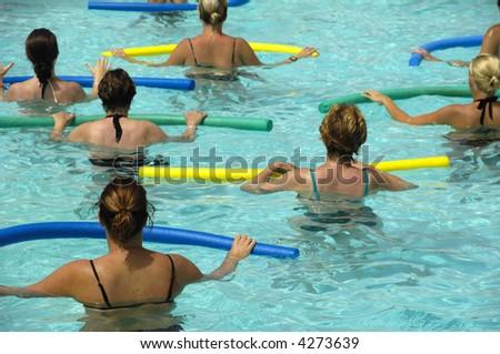 Wemen doing water aerobic in pool - stock photo