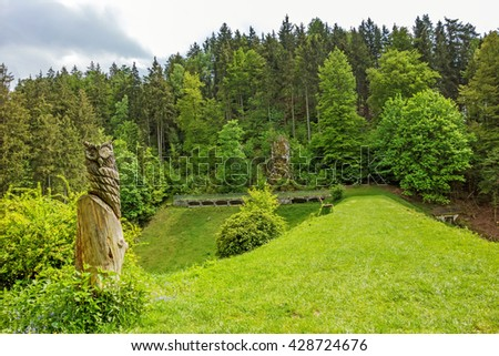 Wental valley reservoir dam - forest / trees in background, carved owl in foreground - Swabian Alps (Schwaebische Alb)