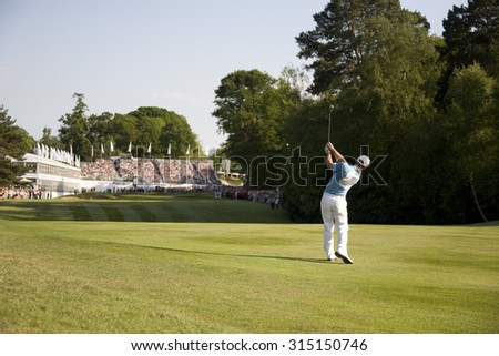 WENTWORTH, ENGLAND. 24 MAY 2009.Paul Casey (GBR) on the approach to the 18th playing in the final round of the European Tour BMW PGA Championship - stock photo