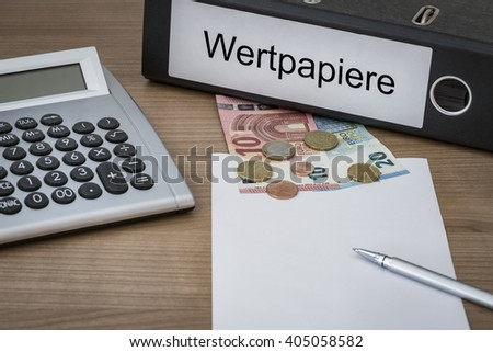 wertpapiere (German security paper) written on a binder on a desk with euro money calculator blank sheet and pen - stock photo