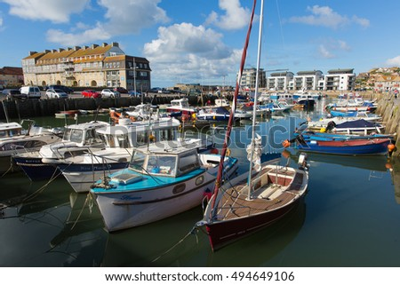 WEST BAY, DORSET, UK-SEPTEMBER 23rd 2016:  Fine calm late summer weather was enjoyed by visitors to West Bay harbour, Dorset, England, UK on Friday 23rd September 2016