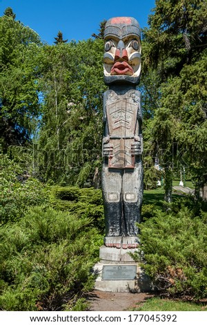 West coast totem pole donated to Alberta Government and sits on legislative grounds. - stock photo