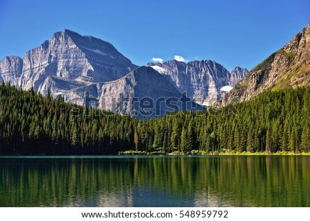 West Face of Mount Gould stands as a backdrop for Grinnell Lake