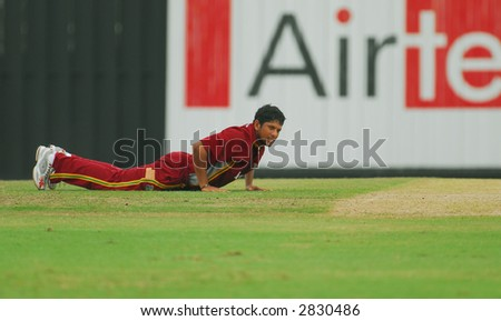 West Indies player in actions during the final of their tri-nations cricket series in Kuala Lumpur - stock photo