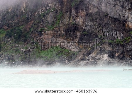WEST JAVA, INDONESIA on May 8, 2016.  Popular tourism attraction of 'Kawah Putih' volcanic crater lake at south of  Bandung, Java, Indonesia. - stock photo