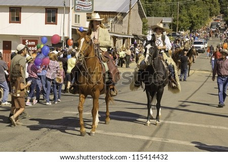 WEST POINT, CA - OCTOBER 6: Unidentified horseback people in the 38th  Lumberjack day  parade, on October 6, 2012 in West Point.