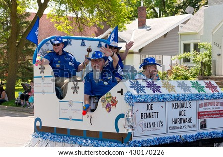 WEST ST. PAUL, MINNESOTA - MAY 21, 2016: St. Paul Winter Carnival Senior Royalty waves to crowd from float during annual West St. Paul Days Grande Parade in West St. Paul on May 21.  - stock photo