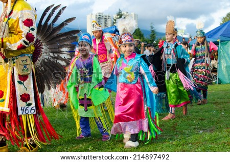 WEST VANCOUVER, BC, CANADA - AUGUST 30 : First Nation Royal Kids take part in Grand Entry of the Squamish Nation 27th Annual Pow Wow in West Vancouver, Canada on August 30 2014 - stock photo