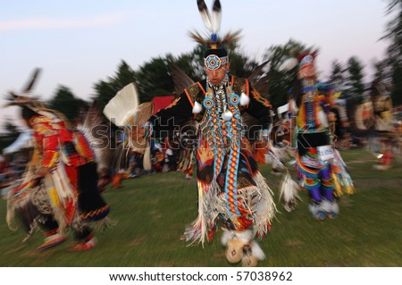 WEST VANCOUVER, BC, CANADA - JULY 10: Native Indian men dance during annual Squamish Nation Pow Wow on July 10, 2010 in West Vancouver, BC, Canada - stock photo