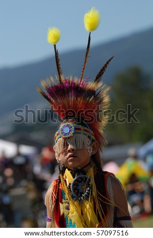 WEST VANCOUVER, BC, CANADA - JULY 10: Portrait of Native Indian boy taken during annual Squamish Nation Pow Wow on July 10, 2010 in West Vancouver, BC, Canada - stock photo