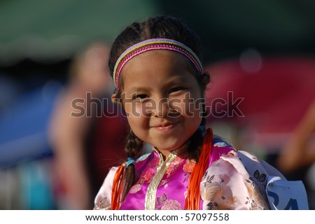 WEST VANCOUVER, BC, CANADA - JULY 10: Portrait of Native Indian girl taken during annual Squamish Nation Pow Wow on July 10, 2010 in West Vancouver, BC, Canada - stock photo