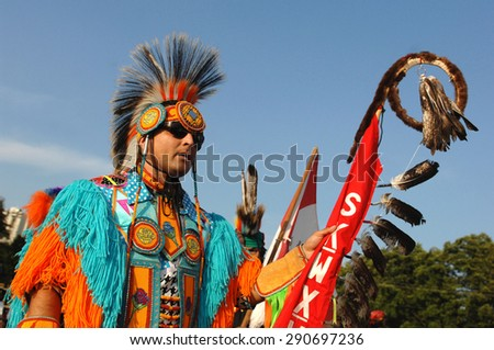 WEST VANCOUVER, CANADA - JULY 8, 2012: Native Indian people participate in the annual Squamish Nation Pow Wow in West Vancouver, British Columbia, Canada, July 8, 2012.