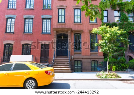 West Village in New York Manhattan building yellow cab USA NYC - stock photo