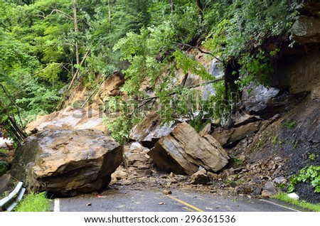 West Virginia Department of Highways workers seek to open highway closed by flashflood caused landslide along Birch River Road, Route 82 in Nicholas County, West Virginia, USA on July 13, 2015 - stock photo