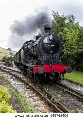 WEST YORKSHIRE. 30 JULY 2013. Keighley and Worth Valley Railway. Steam Train runs for benefit of tourists.   30 July 2013. West Yorkshire. England. - stock photo