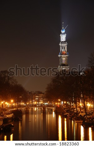 Westerkerk Church and canal at night; Amsterdam, Netherlands