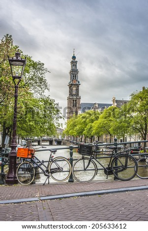 Westerkerk (Western church) next to Jordaan district, on the bank of the Prinsengracht canal in Amsterdam, Netherlands. - stock photo