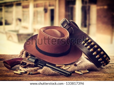Western accessories on wooden table - stock photo