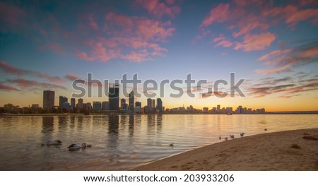 Western Australia - Sunrise View of Perth Skyline from Swan River - stock photo