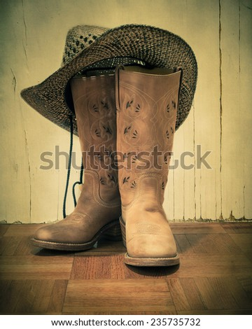 Western boots and hat with vintage tone - stock photo