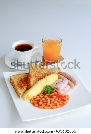 Western Breakfast - French toast, Omelette, Ham, Baked Bean, Sausage ...