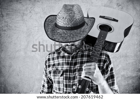 Western country cowboy musician with guitar, black and white portrait. - stock photo