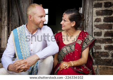 Western couple getting married in an Indian ceremony - stock photo