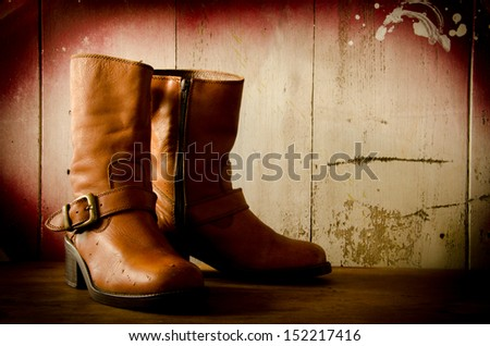 Western cowboy boots ,Still life vintage style - stock photo