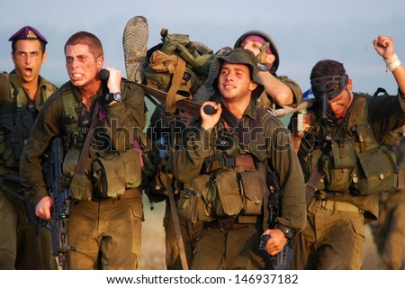 WESTERN NEGEV, ISR - JULY 26:Israeli soldiers during stretcher journey on July 26 2007.The aim is to exercise a scenario of carrying a wounded soldier between 70-120km depending on the IDF army unit. - stock photo