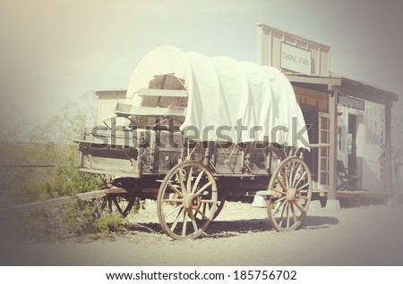 Western wagon and cowboy town general store - stock photo
