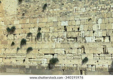 Western Wall in Jerusalem, holy site in judaism as the outside wall for the Second Temple - stock photo