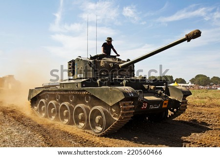 WESTERNHANGER, UK - JULY 18: A vintage WW2 ex British army Cromwell tank gives a display to the watching public at the War & Peace show on July 18, 2014 in Westernhanger - stock photo