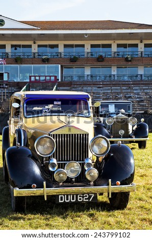 WESTERNHANGER, UK - JULY 17: Two vintage Rolls Royce automobiles are placed on static display on the main concourse for the public to interact with at the W&P show on July 17, 2014 in Westernhanger - stock photo